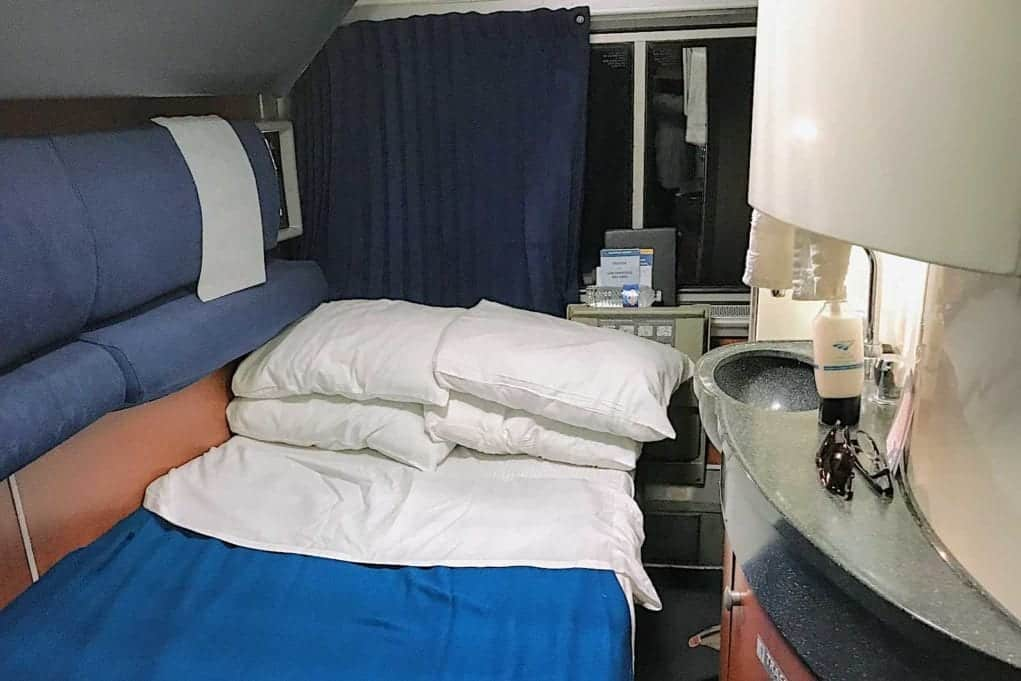 tips for traveling in an Amtrak sleeper car like this deluxe bedroom.