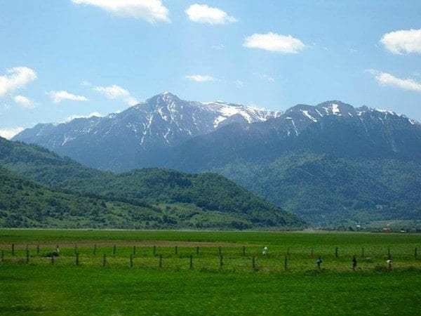 Carpathian mountain range still snow-capped in May seen from the train to Bucharest.