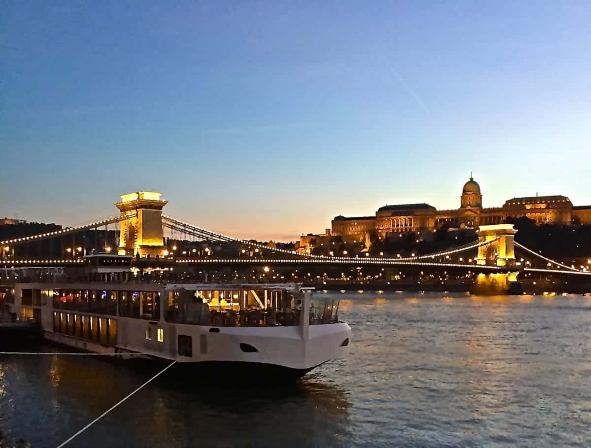 Sunset behind the Buda Castle as the Viking Lif is docked for the night at the Chain Bridge.