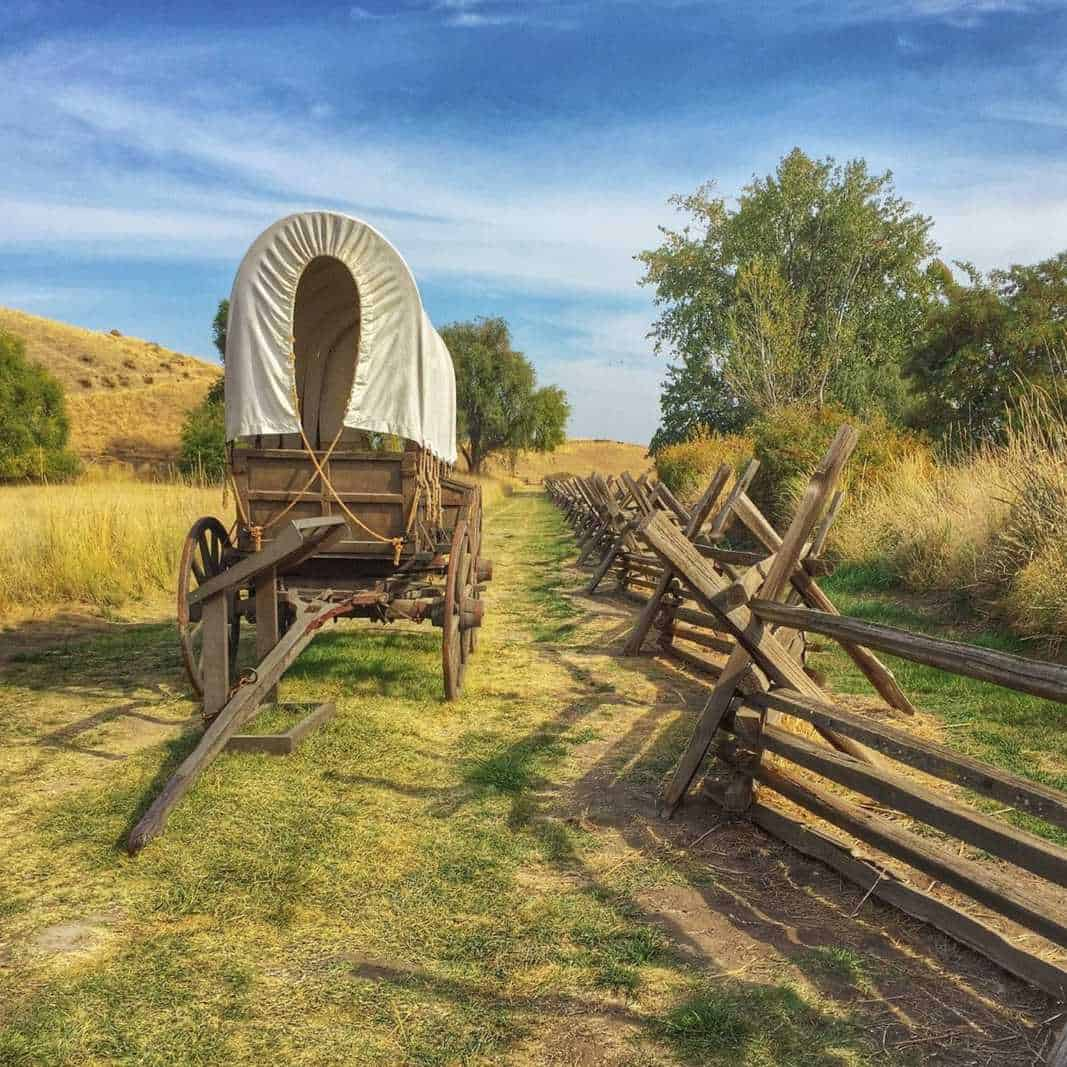 Reconstructed covered wagon sits on the actual wagon ruts of the Oregon Trail.