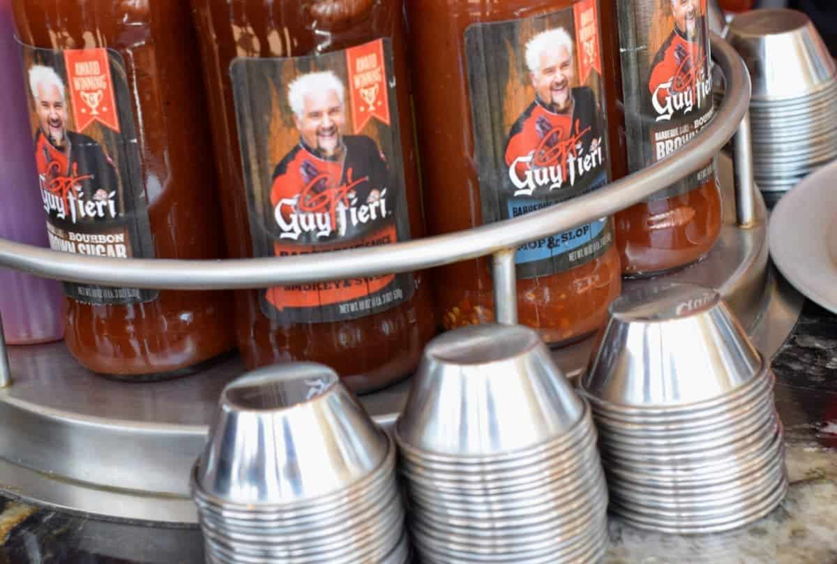A selection of Guy Fieri's sauces for your BBQ.