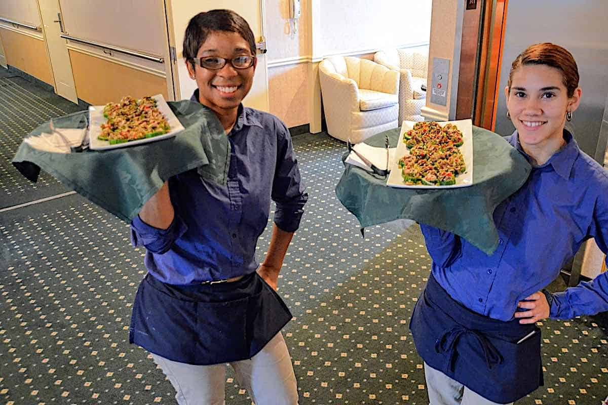 Queen of the Mississippi waitstaff with appetizer trays