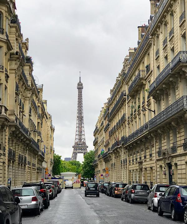Eiffel Tower Paris seen from a narrow street