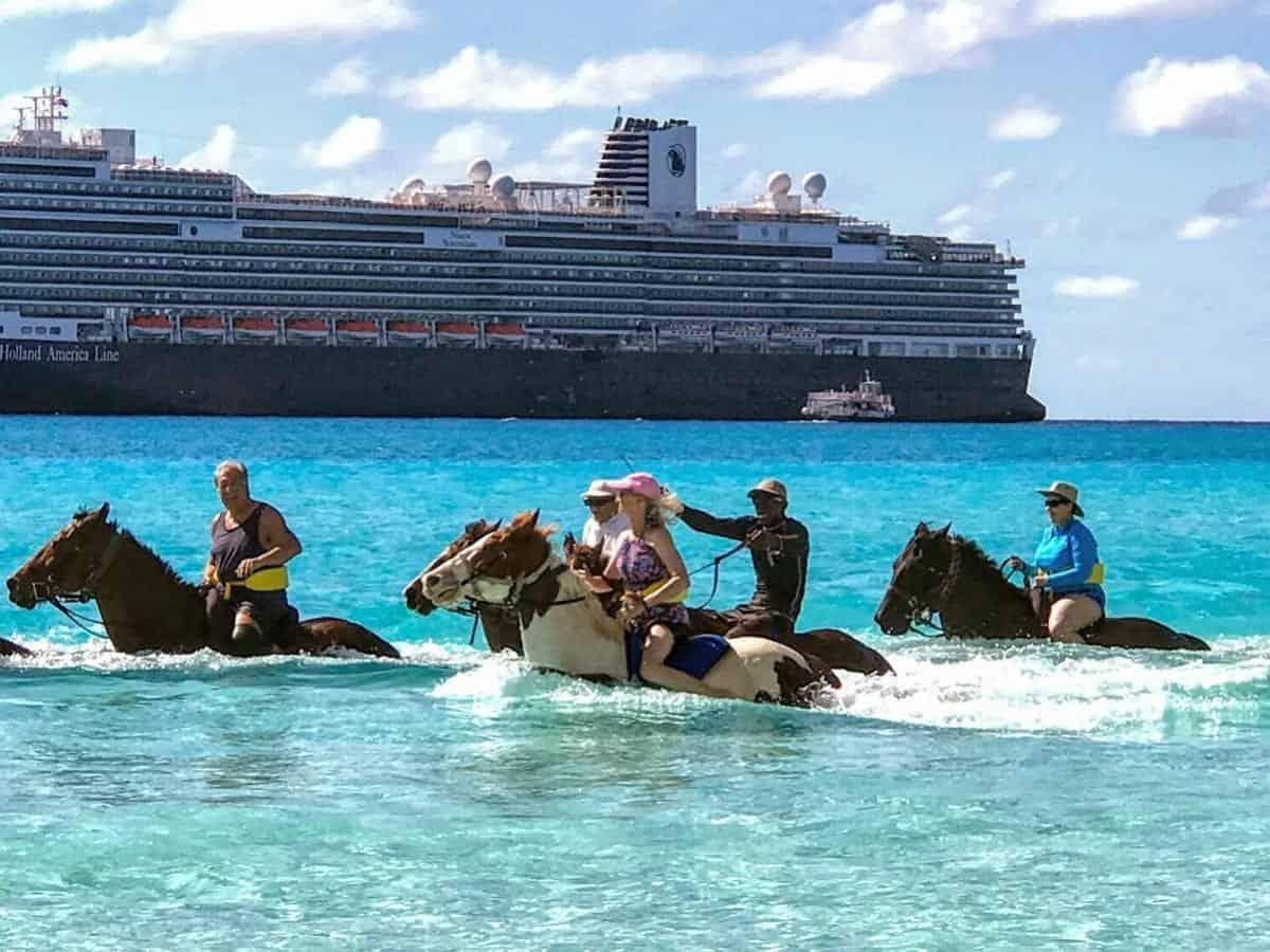 Half Moon Cay Sherry Laskin on horseback in the ocean