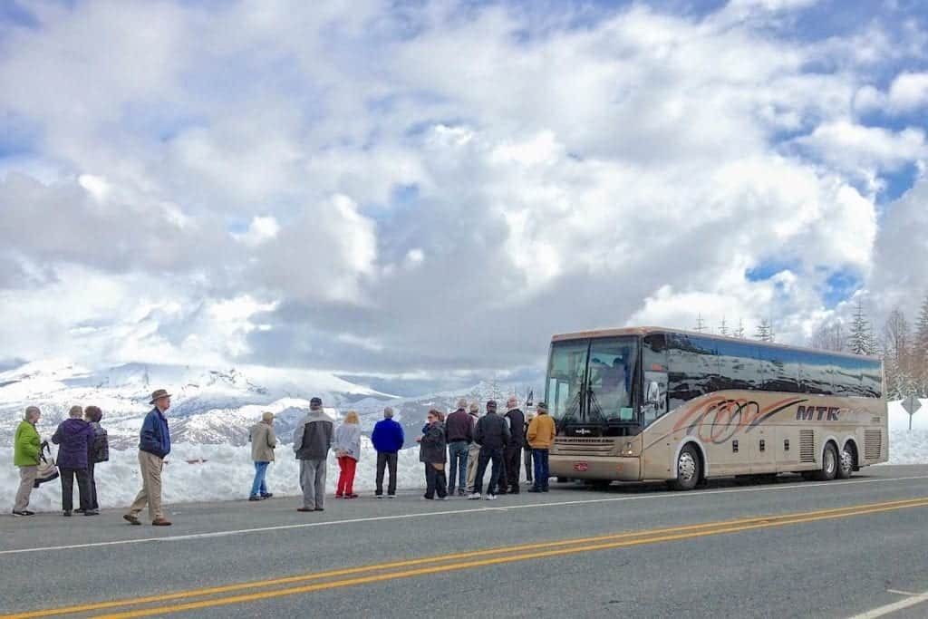 Queen of the West passengers off the bus to look at Mount St. Helens