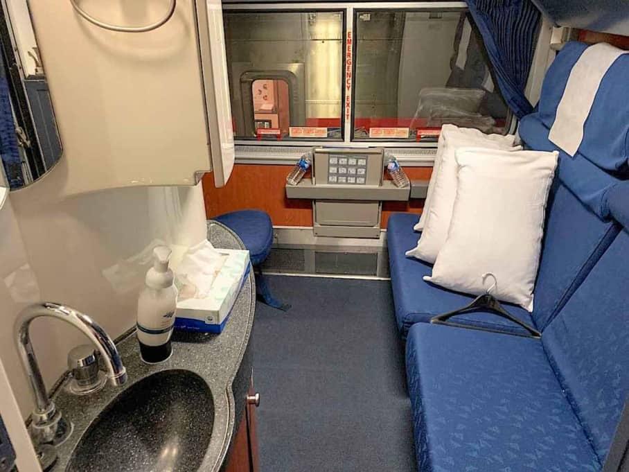 Amtrak Superliner Bedroom with view of sink and vanity area.