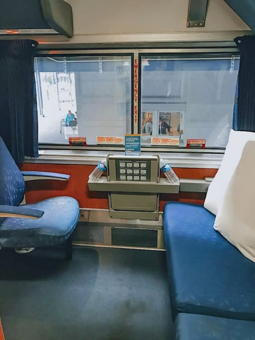 Amtrak Superliner Bedroom with chair and sofa.