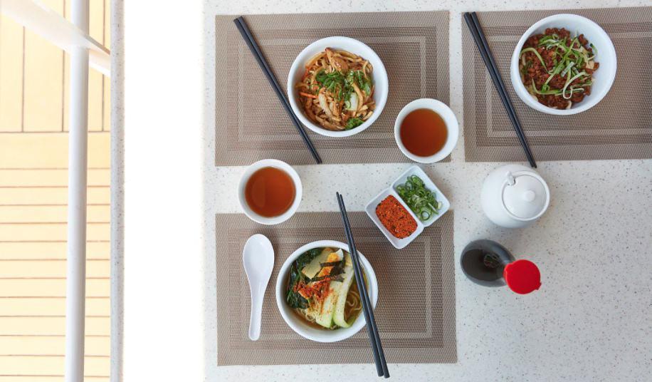 Majestic Princess Chopsticks Noodle Bar aerial view of bowls of soup.