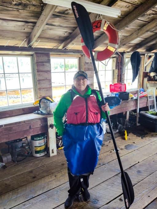 Eagle Island sea kayak gear with life jacket and paddle.
