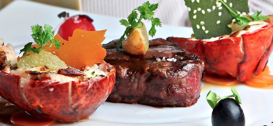 Carnival Fahrenheit 555 Steakhouse steak and lobster plate